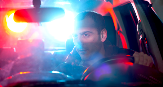 Man-stopped-by-police-patrol-car-Shutterstock-800x430